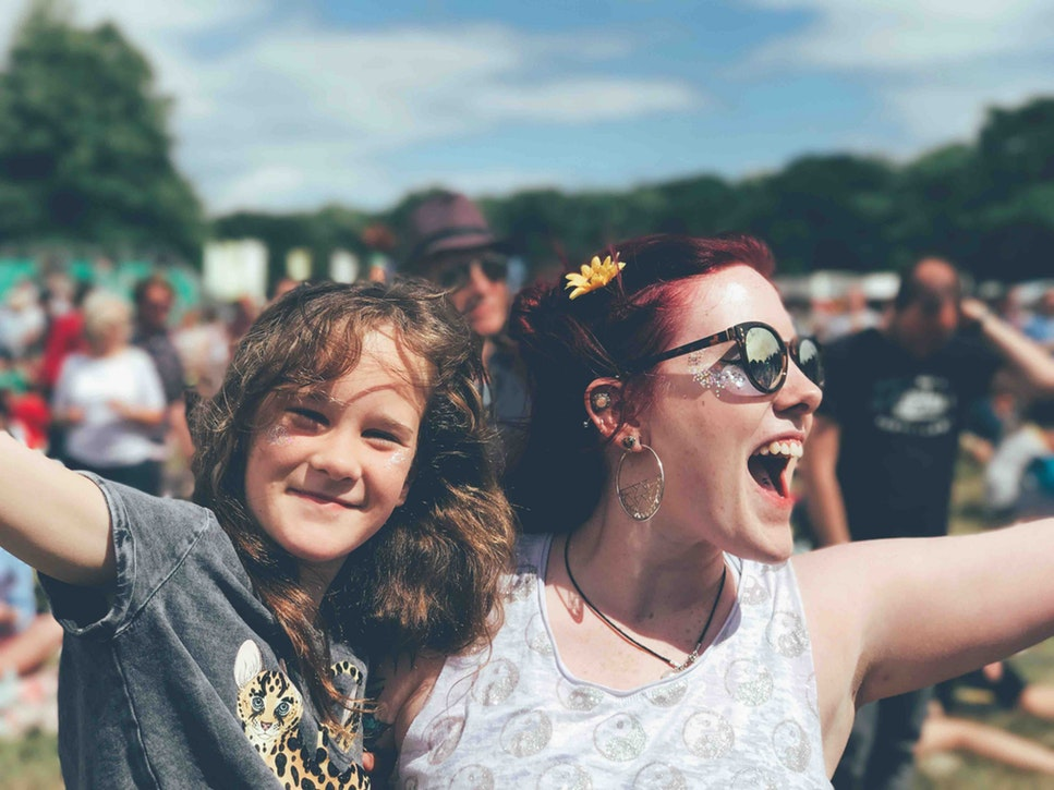 A woman and a young girl at a festival.