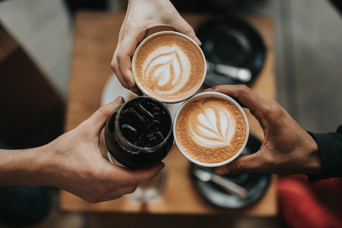 People drinking various types of coffee.
