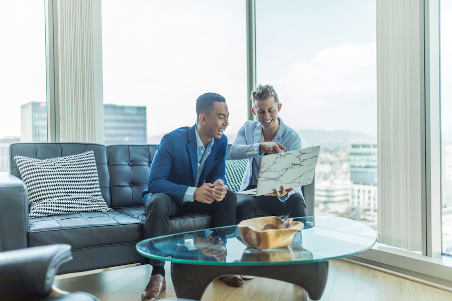 Men on computer discussing real estate resolutions