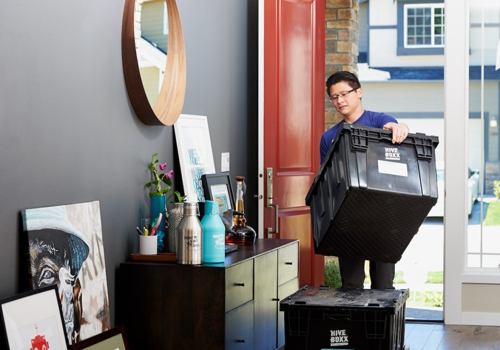 Person decluttering, and other ways to spring clean your home before you list